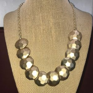 Gold tone chain necklace with hammered discs